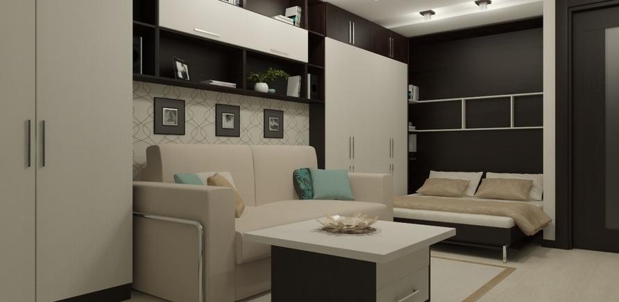 Фото 1 - В этом случае была спроектирована мебель со встроенной выпадающей кроватью и спрятанным туалетным столиком, где достаточно места для хранения вещей и одежды. В то же время в сложенном состоянии комната выглядит как гостиная